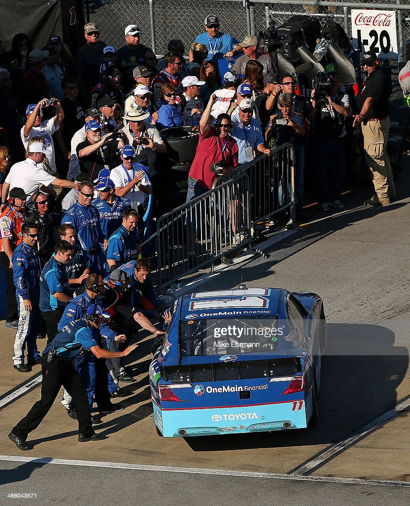 Elliott Sadler, driver of the #11 OneMain Financial Toyota, is congratulated by his crew after winning the NASCAR Nationwide Series Aaron's 312 at Talladega Superspeedway on May 3, 2014 in Talladega, Alabama.