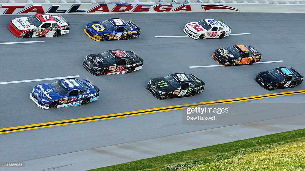Elliott Sadler, driver of the #11 OneMain Financial Toyota, leads a pack of cars during qualifying for the NASCAR Nationwide Series Aaron's 312 at Talladega Superspeedway on May 2, 2014 in Talladega, Alabama.
