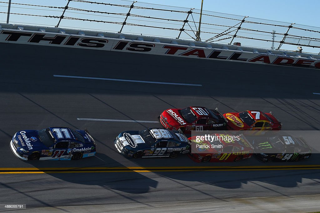 Elliott Sadler driver of the OneMain Financial Toyota leads a pack of cars during the NASCAR Nationwide Series Aaron's 312 at Talladega Superspeedway...