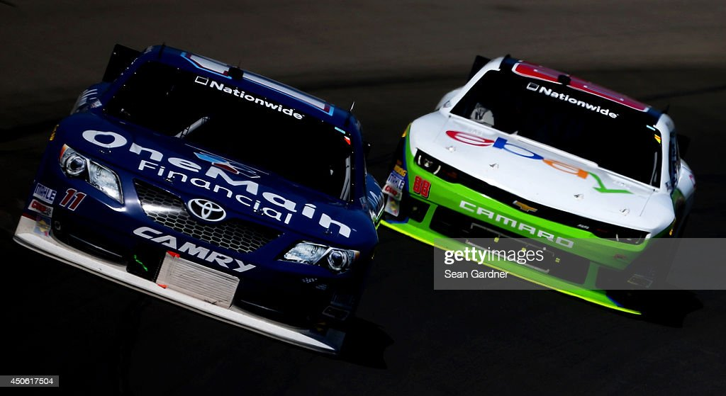 Elliott Sadler, driver of the #11 OneMain Financial Toyota, leads Dale Earnhardt Jr., driver of the #88 eBay Chevrolet, during the NASCAR Nationwide Series Ollie's Bargain Outlet 250 at Michigan International Speedway on June 14, 2014 in Brooklyn, Michigan.