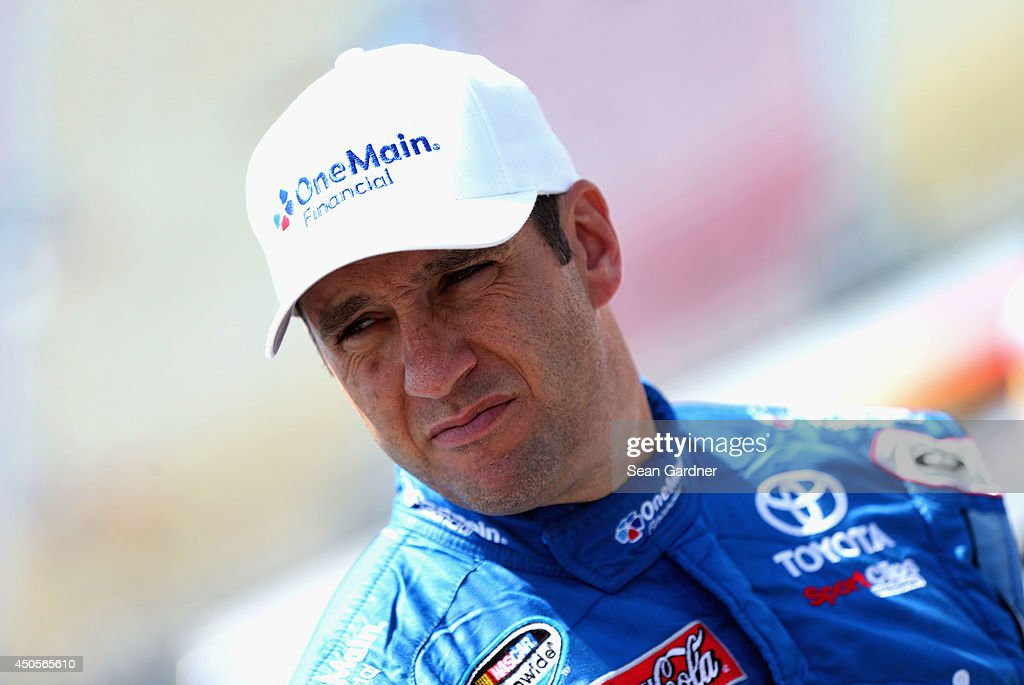 Elliott Sadler, driver of the #11 OneMain Financial Toyota, looks on in the garage area during practice for the NASCAR Nationwide Series Michigan 250 at Michigan International Speedway on June 13, 2014 in Brooklyn, Michigan.