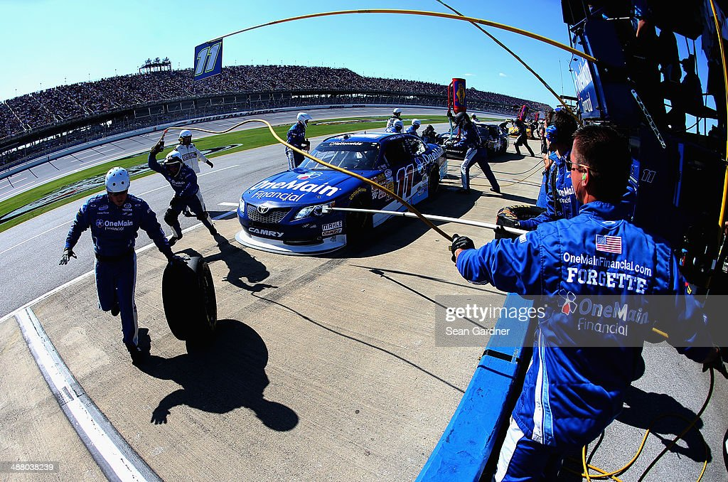 Elliott Sadler driver of the OneMain Financial Toyota pits during the NASCAR Nationwide Series Aaron's 312 at Talladega Superspeedway on May 3 2014...