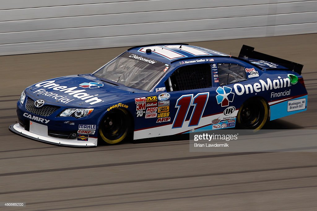 Elliott Sadler, driver of the #11 OneMain Financial Toyota, practices for the NASCAR Nationwide Series Michigan 250 at Michigan International Speedway on June 13, 2014 in Brooklyn, Michigan.