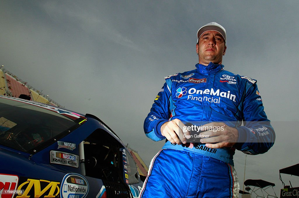 <a gi-track='captionPersonalityLinkClicked' href=/galleries/search?phrase=Elliott+Sadler&family=editorial&specificpeople=204623 ng-click='$event.stopPropagation()'>Elliott Sadler</a>, driver of the #11 OneMain Financial Toyota, stands by his car during qualifying for the NASCAR Nationwide Series Alliance Truck Parts 250 at Michigan International Speedway on June 15, 2013 in Brooklyn, Michigan.