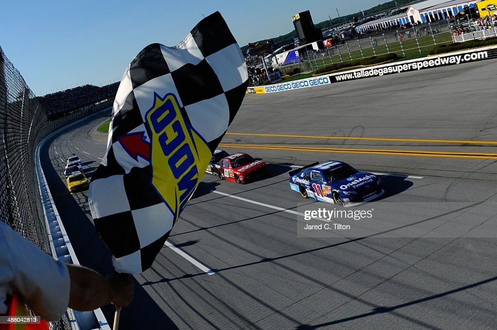 <a gi-track='captionPersonalityLinkClicked' href=/galleries/search?phrase=Elliott+Sadler&family=editorial&specificpeople=204623 ng-click='$event.stopPropagation()'>Elliott Sadler</a>, driver of the #11 OneMain Financial Toyota, takes the checkered flag to win the NASCAR Nationwide Series Aaron's 312 at Talladega Superspeedway on May 3, 2014 in Talladega, Alabama.
