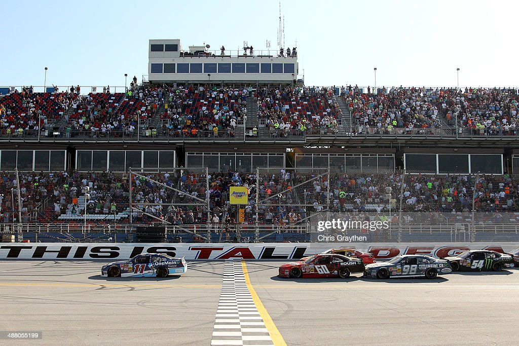 Elliott Sadler, driver of the #11 OneMain Financial Toyota, takes the checkered flag to win the NASCAR Nationwide Series Aaron's 312 at Talladega Superspeedway on May 3, 2014 in Talladega, Alabama.