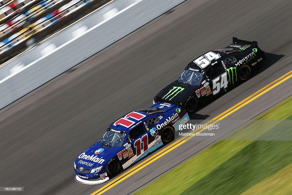 <a gi-track='captionPersonalityLinkClicked' href=/galleries/search?phrase=Elliott+Sadler&family=editorial&specificpeople=204623 ng-click='$event.stopPropagation()'>Elliott Sadler</a>, driver of the #11 OneMain Toyota, leads against <a gi-track='captionPersonalityLinkClicked' href=/galleries/search?phrase=Kyle+Busch&family=editorial&specificpeople=211123 ng-click='$event.stopPropagation()'>Kyle Busch</a>, driver of the #54 Monster Toyota, during practice for the NASCAR Sprint Cup Series Daytona 500 at Daytona International Speedway on February 23, 2013 in Daytona Beach, Florida.