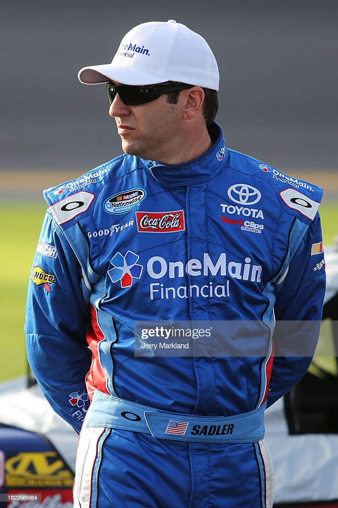 <a gi-track='captionPersonalityLinkClicked' href=/galleries/search?phrase=Elliott+Sadler&family=editorial&specificpeople=204623 ng-click='$event.stopPropagation()'>Elliott Sadler</a>, driver of the #11 OneMain Toyota, stands on the grid during qualifying for the NASCAR Nationwide Series DRIVE4COPD 300 at Daytona International Speedway on February 22, 2013 in Daytona Beach, Florida.