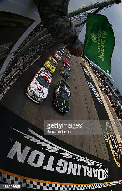 Elliott Sadler driver of the SportClips Toyota and Kyle Busch driver of the Monster Energy Toyota lead the field at the start of the NASCAR...