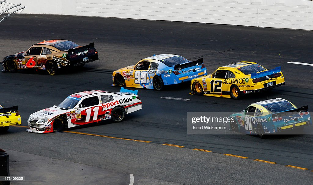 <a gi-track='captionPersonalityLinkClicked' href=/galleries/search?phrase=Elliott+Sadler&family=editorial&specificpeople=204623 ng-click='$event.stopPropagation()'>Elliott Sadler</a>, driver of the #11 SportsClips Toyota, spints out in the final try for a green, white, checkered finish during the NASCAR Nationwide Series CNBC Prime's The Profit 200 at New Hampshire Motor Speedway on July 13, 2013 in Loudon, New Hampshire.