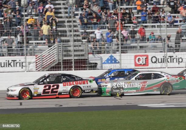 Elliott Sadler JR Motorsports Hunt Brothers Pizza Chevrolet Camaro pushing Brad Keselowski Penske Racing Discount Tire Ford Mustang on a late restart...