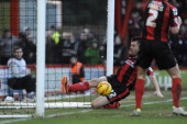 Elliott Ward of Bournemouth fails to keep the ball out of the net as Kevin Phillips of Leicester City scores the winning goal during the Sky Bet...