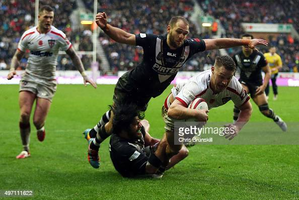Elliott Whitehead of England goes over for a try during the match between England and New Zealand at the DW Stadium on November 14 2015 in Wigan...