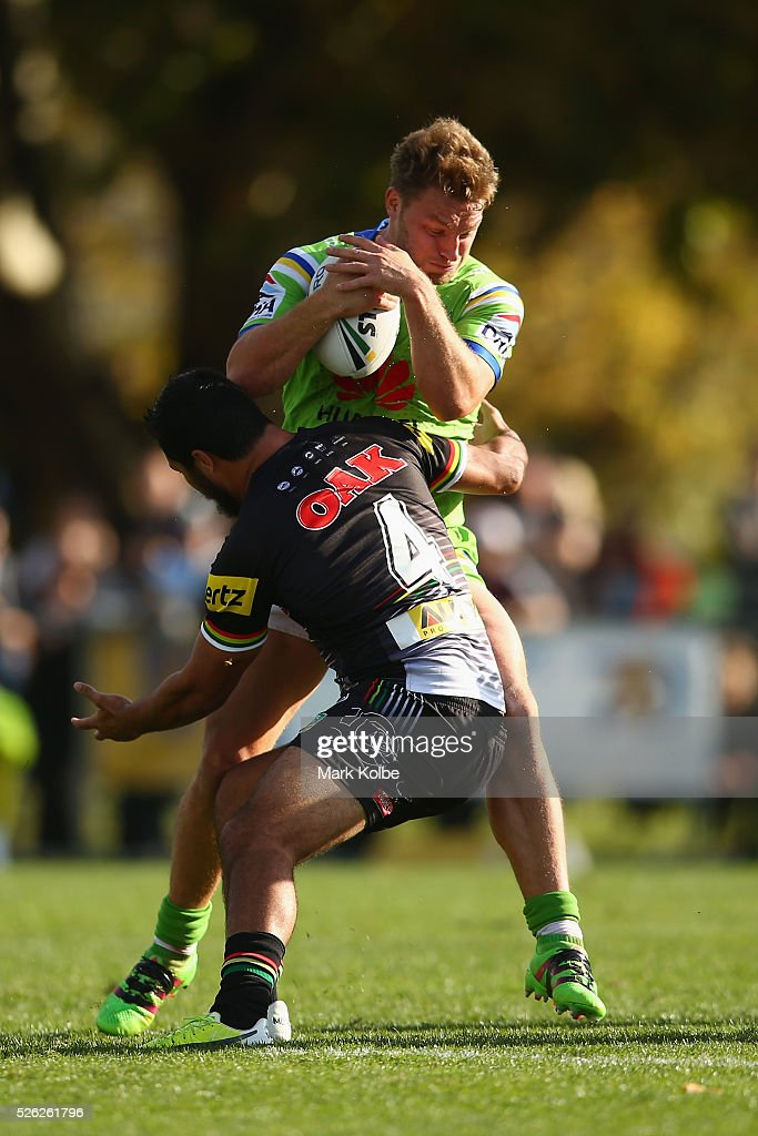 Elliott Whitehead of the Raiders is tackled by Peta Hiku of the Panthers during the round nine NRL match between the Penrith Panthers and the Canberra Raiders at Carrington Park on April 30, 2016 in Bathurst, Australia.