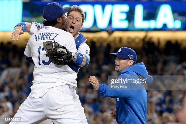 J Ellis and Hanley Ramirez of the Los Angeles Dodgers celebrate after the Dodgers defeat the Atlanta Braves 43 in Game Four of the National League...