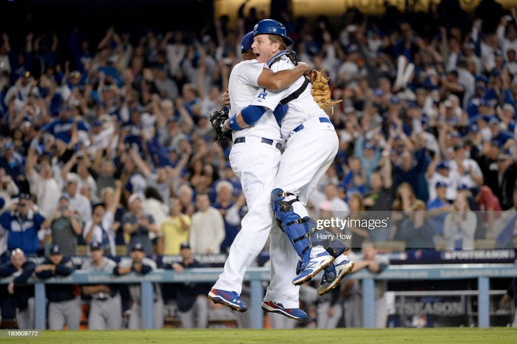 A.J. Ellis #17 and <a gi-track='captionPersonalityLinkClicked' href=/galleries/search?phrase=Kenley+Jansen&family=editorial&specificpeople=5751411 ng-click='$event.stopPropagation()'>Kenley Jansen</a> #74 of the Los Angeles Dodgers celebrate after the Dodgers defeat the Atlanta Braves 4-3 in Game Four of the National League Division Series at Dodger Stadium on October 7, 2013 in Los Angeles, California.