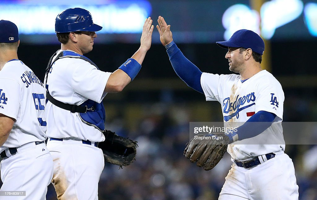 A.J. Ellis #17 and <a gi-track='captionPersonalityLinkClicked' href=/galleries/search?phrase=Nick+Punto&family=editorial&specificpeople=547246 ng-click='$event.stopPropagation()'>Nick Punto</a> #7 of the Los Angeles Dodgers high five after the game against the New York Mets at Dodger Stadium on August 13, 2013 in Los Angeles, California. Ellis and Punto both had two run hits as the Dodgers won 4-2.