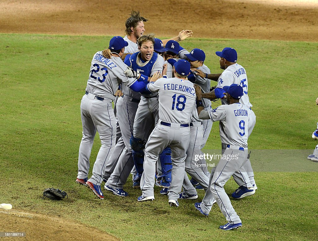 Ellis #17 and teammates of the Los Angeles Dodgers celebrate clinching the National League West Division Title against the Arizona Diamondbacks after a 7-6 win at Chase Field on September 19, 2013 in Phoenix, Arizona.