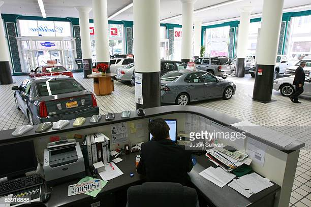 Ellis Brooks Chevrolet owner John Brooks makes phone calls while waiting for customers December 4 2008 in San Francisco California The fate of car...