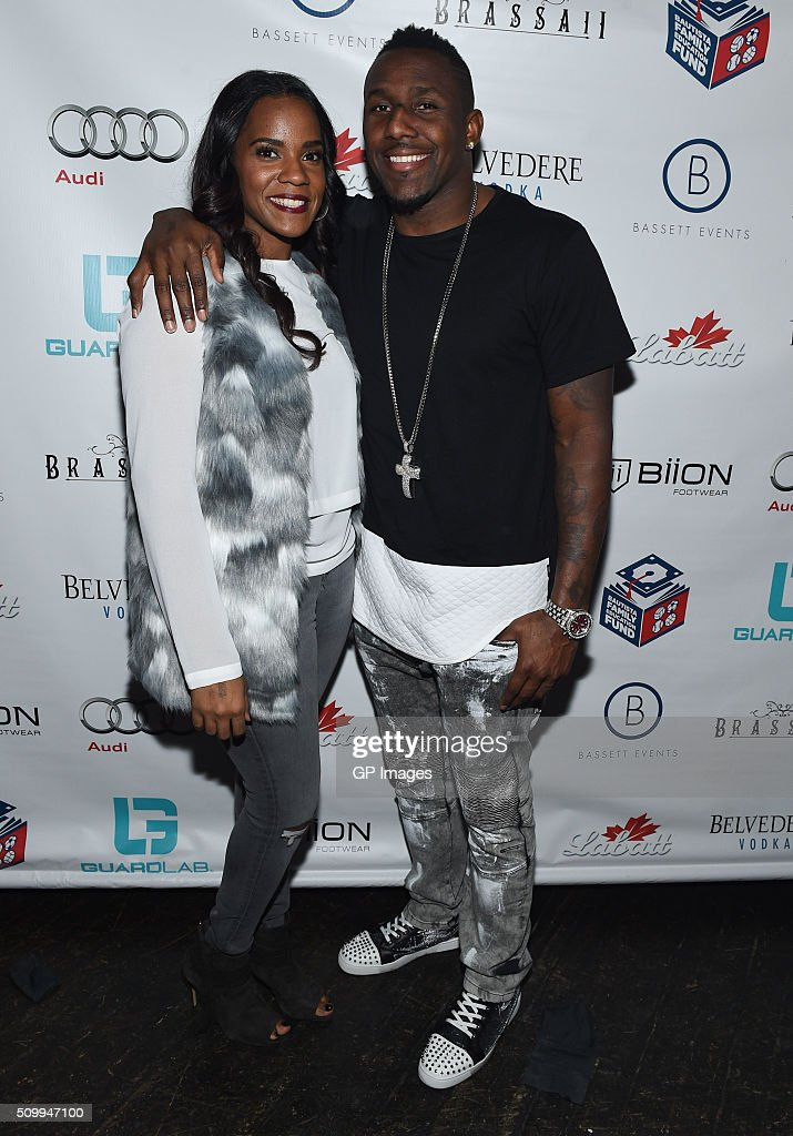 Ellis Davis and Carolina Panthers Thomas Davis attends the Jose Bautista All-Star Weekend kick-off party with special guest set by DJ Snoopadelic A.K.A Snoop Dogg sponsored by GuardLab at Brassaii on February 13, 2016 in Toronto, Canada.