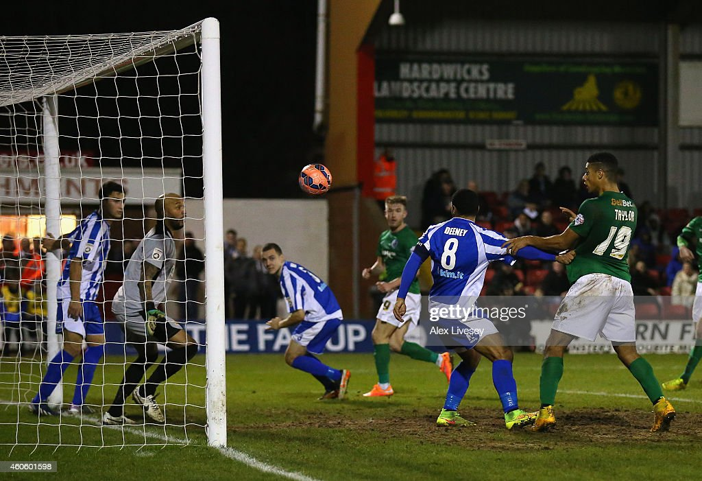 Ellis Deeney and Nathan Vaughan of Worcester City fail to keep the ball out of the net as Paddy Madden of Scunthorpe United scores the opening goal during the FA Cup Second Round Replay match between Worcester City and Scunthorpe United at Aggborough Stadium on December 17, 2014 in Worcester, England.