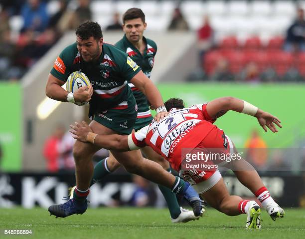Ellis Genge of Leicester is tackled by Motu Matu'u during the Aviva Premiership match between Leicester Tigers and Gloucester Rugby at Welford Road...