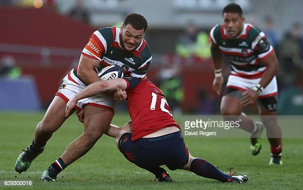 Ellis Genge of Leicester is tackled by Tyler Bleyendaal during the European Champions Cup match between Munster and Leicester Tigers at Thomond Park...