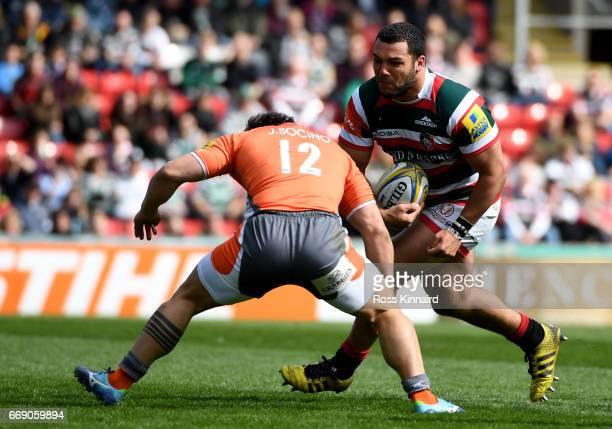 Ellis Genge of Leicester Tigers id tackled by Juan Pablo Socino of Newcastle Falcons during the Aviva Premiership match between Leicester Tigers and...