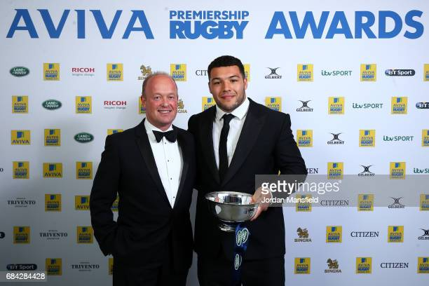Ellis Genge of Leicester Tigers is presented the Land Rover Discovery of the Season Award by Managing Director for Jaguar Land Rover UK Jeremy Hicks...