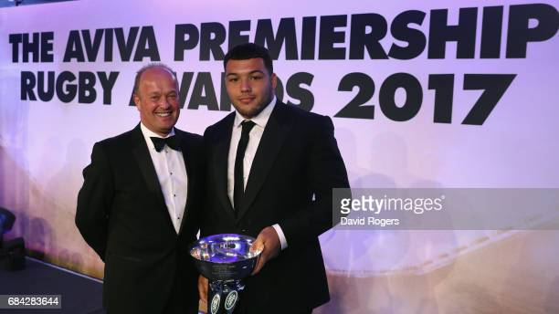 Ellis Genge of Leicester Tigers receives the Land Rover Discovery of the Season award from Jeremy Hicks managing director of Jaguar Land Rover UK...