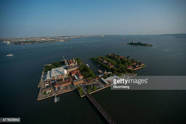 Ellis Island stands in this aerial photograph taken above New York US on Wednesday June 10 2015 US stocks rallied and the dollar fell as the Federal...