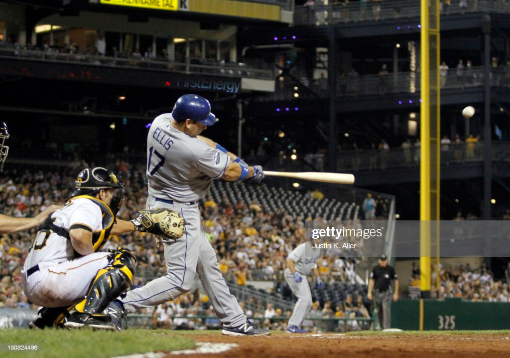 A.J. Ellis #17 of the Los Angeles Dodgers hits a sac fly in the seventh inning against the Pittsburgh Pirates during the game on August 15, 2012 at PNC Park in Pittsburgh, Pennsylvania.