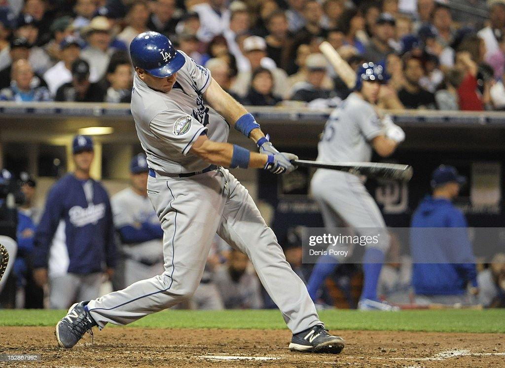 A.J. Ellis #17 of the Los Angeles Dodgers hits an RBI single during the fourth inning of a baseball game against the San Diego Padres at Petco Park on September 27, 2012 in San Diego, California.