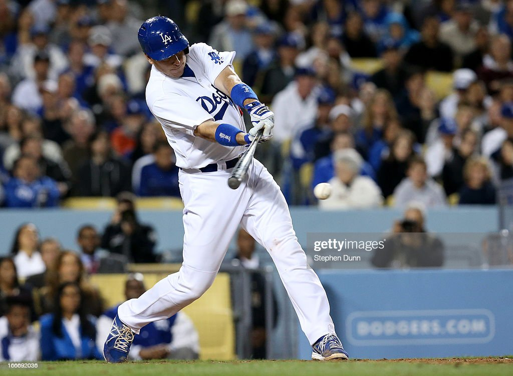 A.J. Ellis of the Los Angeles Dodgers hits an RBI single in the fifth inning against the San Diego Padres at Dodger Stadium on April 15, 2013 in Los Angeles, California. All uniformed team members are wearing jersey number 42 in honor of Jackie Robinson Day.