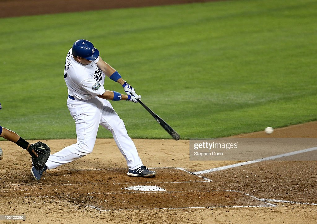 A.J. Ellis #17 of the Los Angeles Dodgers hits an RBI single in the fourth inning against the Colorado Rockies on September 29, 2012 at Dodger Stadium in Los Angeles, California.