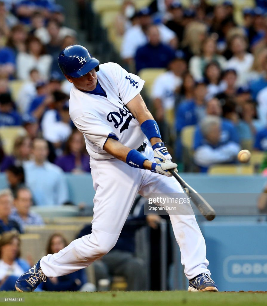 A.J. Ellis #17 of the Los Angeles Dodgers hits an RBI single in the third inning against the Milwaukee Brewers at Dodger Stadium on April 27, 2013 in Los Angeles, California.