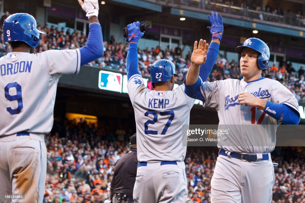 A.J. Ellis #17 of the Los Angeles Dodgers is congratulated by <a gi-track='captionPersonalityLinkClicked' href=/galleries/search?phrase=Matt+Kemp&family=editorial&specificpeople=567161 ng-click='$event.stopPropagation()'>Matt Kemp</a> #27 and <a gi-track='captionPersonalityLinkClicked' href=/galleries/search?phrase=Dee+Gordon&family=editorial&specificpeople=7091343 ng-click='$event.stopPropagation()'>Dee Gordon</a> #9 after Ellis and Kemp scored runs against the San Francisco Giants during the eighth inning at AT&T Park on May 5, 2013 in San Francisco, California.