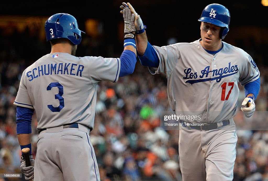 A.J. Ellis #17 of the Los Angeles Dodgers is congratulated by Skip Schumaker #3 after Ellis hit a solo home run against the San Francisco Giants in the fourth inning at AT&T Park on May 4, 2013 in San Francisco, California.