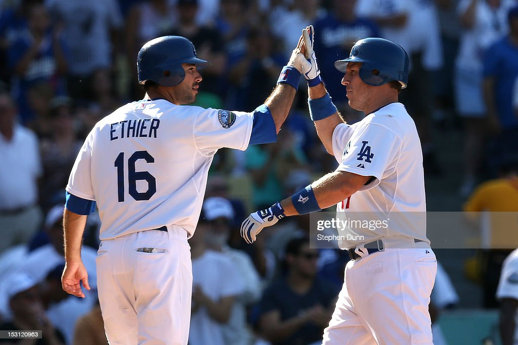 A.J. Ellis #17 of the Los Angeles Dodgers is greeted by Andre Ethier #16 after both score on Ellis' two run home run in the sixth inning against the Colorado Rockies on September 30, 2012 at Dodger Stadium in Los Angeles, California. The Dodgers won 7-1.