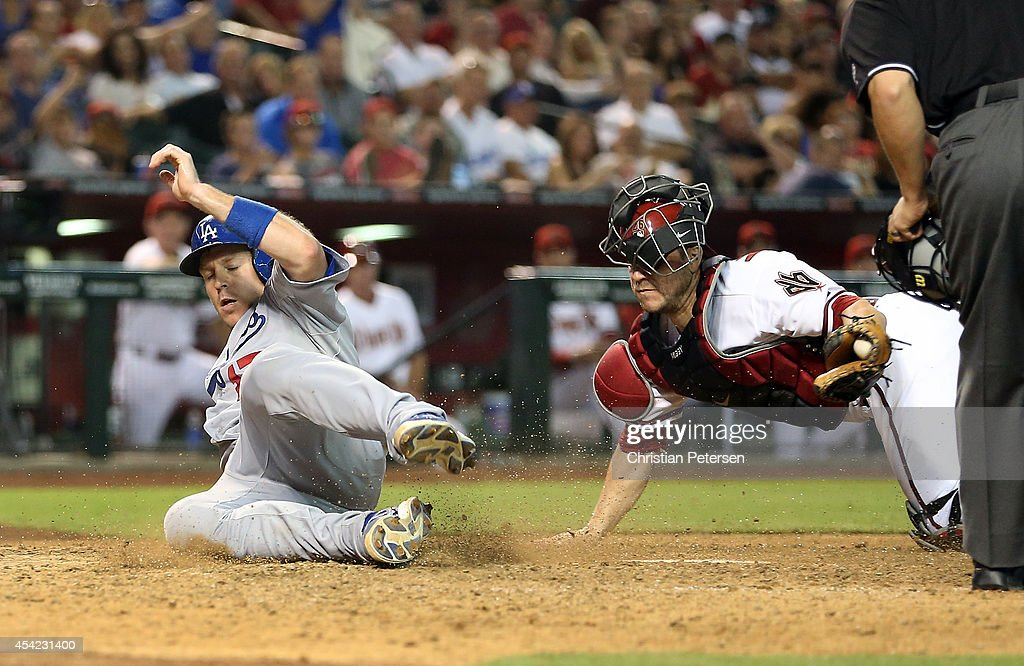 A.J. Ellis #17 of the Los Angeles Dodgers is tagged out at home plate by catcher <a gi-track='captionPersonalityLinkClicked' href=/galleries/search?phrase=Miguel+Montero&family=editorial&specificpeople=836495 ng-click='$event.stopPropagation()'>Miguel Montero</a> #26 of the Arizona Diamondbacks during the sixth inning of the MLB game at Chase Field on August 26, 2014 in Phoenix, Arizona.