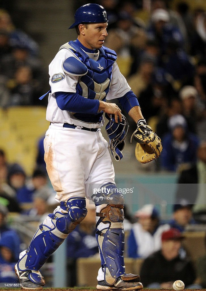 A.J. Ellis #17 of the Los Angeles Dodgers picks up the ball after blocking it preventing a wild pitch against the San Diego Padres at Dodger Stadium on April 13, 2012 in Los Angeles, California.