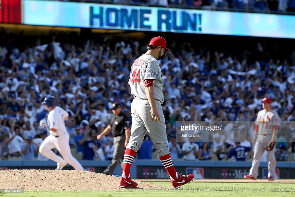 A.J. Ellis #17 of the Los Angeles Dodgers rounds the bases after hitting a solo home off <a gi-track='captionPersonalityLinkClicked' href=/galleries/search?phrase=Edward+Mujica&family=editorial&specificpeople=836179 ng-click='$event.stopPropagation()'>Edward Mujica</a> #44 of the St. Louis Cardinals in the seventh inning in Game Five of the National League Championship Series at Dodger Stadium on October 16, 2013 in Los Angeles, California.