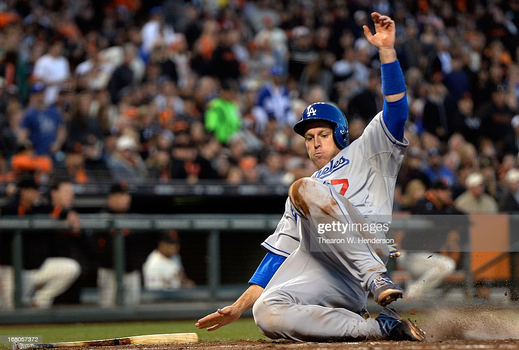A.J. Ellis #17 of the Los Angeles Dodgers scores against the San Francisco Giants in the fifth inning at AT&T Park on May 4, 2013 in San Francisco, California. Ellis scored from second base on a Juan Uribe single.