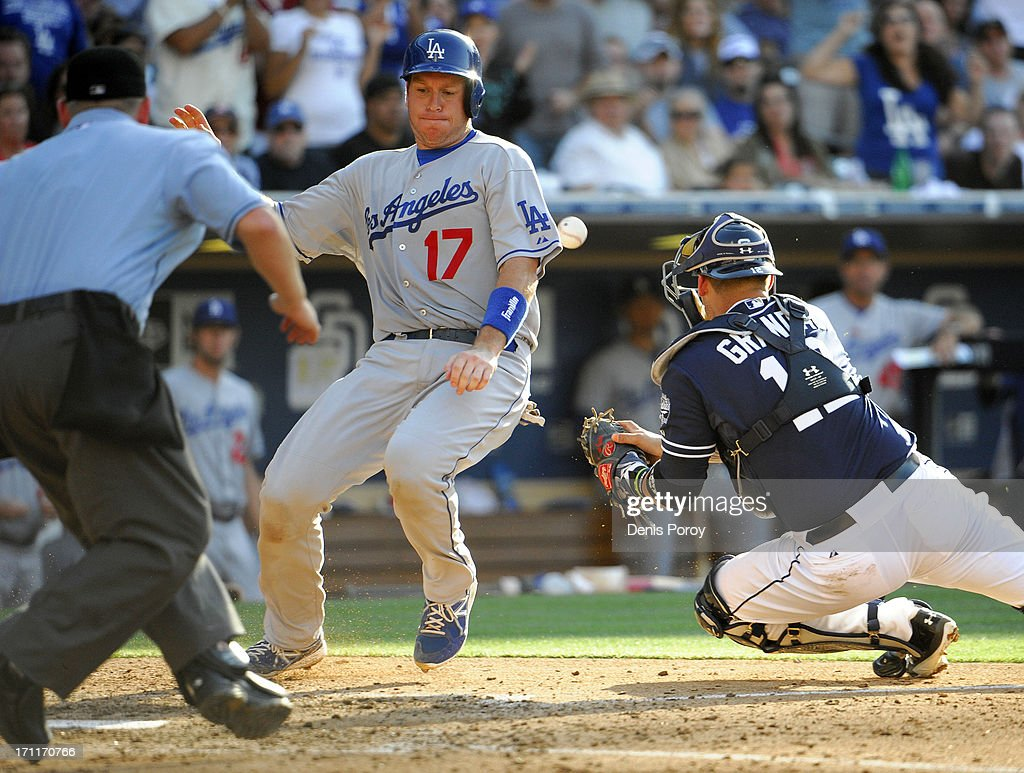 A.J. Ellis #17 of the Los Angeles Dodgers scores as <a gi-track='captionPersonalityLinkClicked' href=/galleries/search?phrase=Yasmani+Grandal&family=editorial&specificpeople=7510522 ng-click='$event.stopPropagation()'>Yasmani Grandal</a> #12 of the San Diego Padres loses the ball during the sixth inning of a baseball game at Petco Park on June 22, 2013 in San Diego, California.
