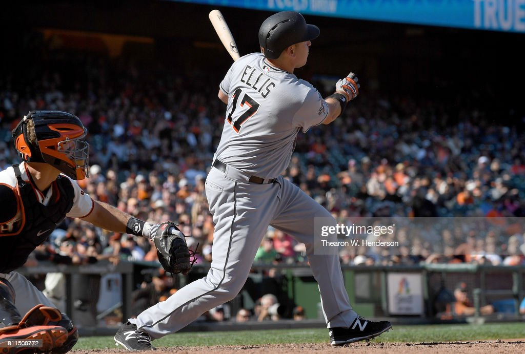 A.J. Ellis #17 of the Miami Marlins hits a two-run homer against the San Francisco Giants in the top of the 11th inning at AT&T Park on July 9, 2017 in San Francisco, California. The Marlins won the game 10-8.