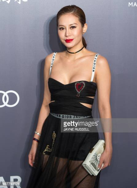 Elly Lam daughter of Peter Lam and Lynn Hsieh poses on the red carpet during the 2017 American Foundation for AIDS Research Hong Kong gala at Shaw...