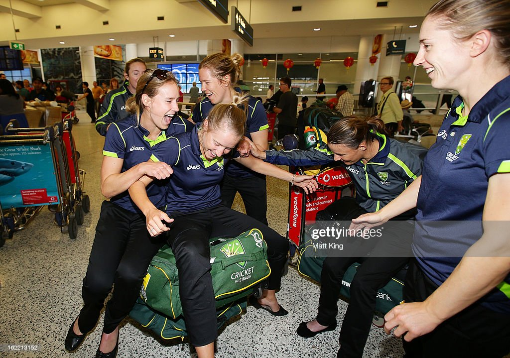 Ellyse Perry, Alyssa Healy, Alex Blackwell, Erin Osborne and Rachael Haynes of the Australian women's cricket team share a laugh after arriving home following their win in the 2013 World Cup at Sydney International Airport on February 21, 2013 in Sydney, Australia.