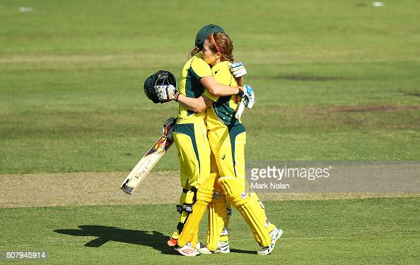 Ellyse Perry and Alex Blackwell of Australia embrace after Blackwell scored a century during game one of the Women's ODI series between Australia and...