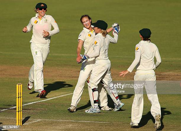 Ellyse Perry and Jodie Fields of Australia celebrate the wicket of Lydia Greenway of England during day two of the Women's Ashes Test match between...
