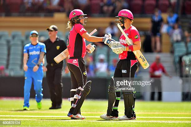 Ellyse Perry and Sarah Aley of the Sixers congratulate each other after defeating the Strikers during the WBBL match between the Strikers and Sixers...